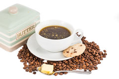 Black coffee with added butter, accompanied with butter cookie Royalty Free Stock Photos
