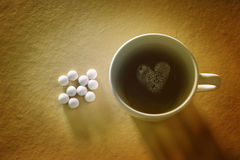 Black coffee and aspirins pills Royalty Free Stock Image