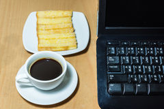 Black coffee and baked bread on a table Royalty Free Stock Images