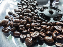 black coffee bean in the coffer machine Royalty Free Stock Images