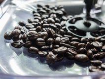 black coffee bean in the coffer machine Stock Photo