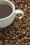 Black coffee and beans Stock Image