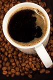 Black coffee and beans Stock Photos