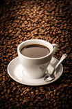 Black coffee on beans background Royalty Free Stock Images