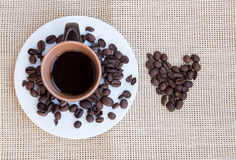 Black coffee and beans Stock Photography