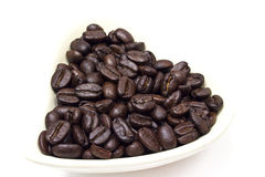 Black coffee beans in heart shaped bowl. Stock Photography