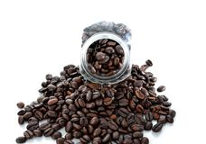 Black coffee beans isolated white background. Black coffee beans and  bottle isolated Royalty Free Stock Images