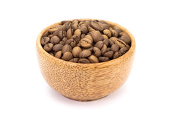 Black coffee beans in wood cup Stock Image
