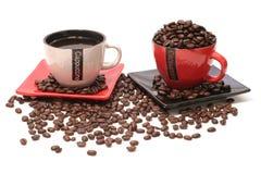 Black coffee and beens. Inside mug Royalty Free Stock Photography