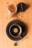 Black coffee in black cup and jar of coffee on the wooden table Stock Image