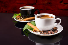 Black Coffee in Black and White Cups with Spices. Still Life Close Up of Black Coffee Served in Black and White Contrasting Cups with Saucers Garnished with Stock Photography