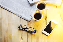 Black coffee with blank digital tablet and mobile phone, magazin Stock Image