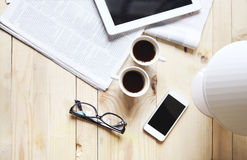 Black coffee with blank digital tablet and mobile phone, magazin Royalty Free Stock Images