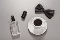 Black coffee with a bow tie and eau de toilette Royalty Free Stock Photos