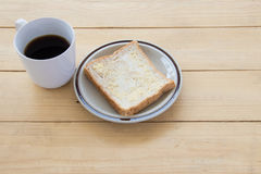Black coffee and bread on wooden of brown,high angle view Stock Photography