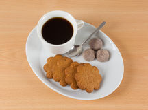 Black coffee. With brown cookies Stock Photos