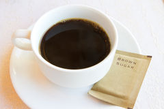 Black coffee with brown sugar Stock Images