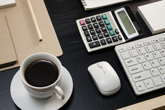 Black coffee with business objects on black wood table. Royalty Free Stock Photography