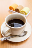 Black coffee with cake Stock Image
