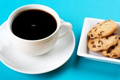 Black coffee and cakes. Royalty Free Stock Images