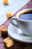 Black coffee with cane sugar Royalty Free Stock Photography
