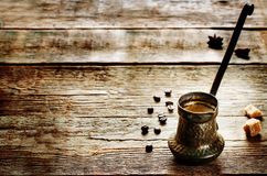 Black coffee in the cezve Royalty Free Stock Image