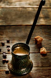 Black coffee in the cezve Royalty Free Stock Photo