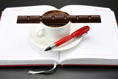 Black coffee and chocolate on the table from a business person Royalty Free Stock Photo