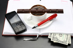 Black coffee and chocolate on the table from a business person Stock Image