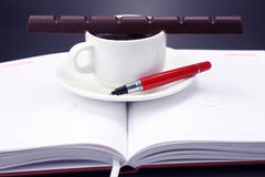Black coffee and chocolate on the table from a business person Royalty Free Stock Photography