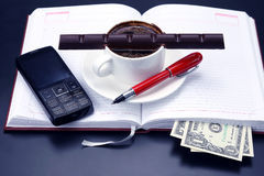 Black coffee and chocolate on the table from a business person Royalty Free Stock Images