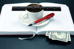 Black coffee and chocolate on the table from a business person Stock Photo