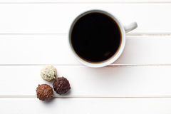 Black coffee with chocolate truffles Royalty Free Stock Image