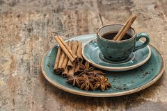 Black coffee cinnamon star anise spices Vintage. Black coffee with cinnamon and star anise spices. Vintage still life Stock Photography