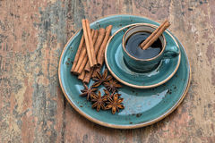 Black coffee with cinnamon and star anise spices. Vintage still Royalty Free Stock Photo