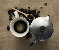 Black coffee and coffe pot. Black coffee and coffee pot in vintage style royalty free stock images