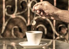 Free Black Coffee. Coffe Time, Spoon. Hand Of Man Hold Coffee Spoon, Or Coffe Cup. Cappuccino And Black Espresso Coffe Cup Royalty Free Stock Images - 175443529