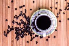 Black coffee and coffee bean Stock Photos