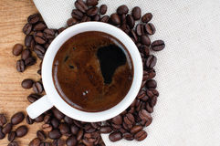 Black coffee and coffee beans Stock Images