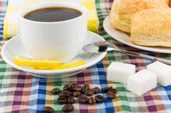 Black coffee and coffee beans, sugar and flaky biscuits Stock Photo