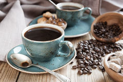 Black coffee and coffee beans Royalty Free Stock Photography