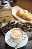 Black coffee with coffee beans an whirlybird Stock Image