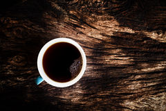 Black coffee in a coffee cup on wooden table. - DARK TONE Stock Images