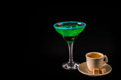 Black coffee and colorful drink in a cocktail glass, with ice cu Royalty Free Stock Photos