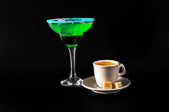 Black coffee and colorful drink in a cocktail glass, with ice cu Stock Photography