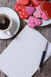 Black coffee, colorful heart cookies and a note Stock Photo