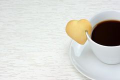 Black coffee with cookie Stock Photo