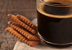 Black coffee and cookies Royalty Free Stock Photos