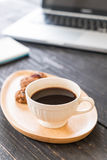 Black coffee and cookies with laptop and note book Stock Image