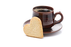 Black coffee and cookies in the shape of heart, isolated Stock Photos